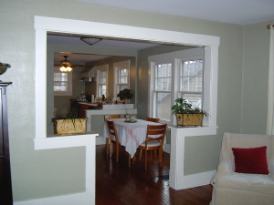 A Cased Double Opening With Knee Wall Separates The Living Room From Dining And Only Kitchen In This Open Floor Plan